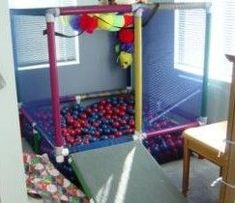Covered with Netting, Painted and then Filled with Plastic Balls, this Play Structure Becomes an Indoor Ball Pit. Door/Ramp Swings Upward with Slip Tees as Hinges. Pvc Pipe Projects, Indoor Playground, Playground Ideas, Toy Rooms, Diy Toys, Diy For Kids, Kids Playing, Activities For Kids, Kids Room