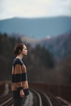 Girl on the railway bridge | by Oleh Slobodeniuk
