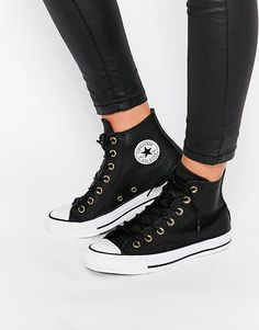 Image 1 ofConverse Perforated Leather Chuck Taylor Hi Top Trainers