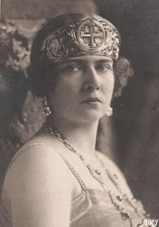 This golden diadem was made for Queen Marie of Romania in late 1910s. It is composed of flower motifs with a large Orthodox Cross in the middle. There are no precious stones, no additional decorations – just a plain solid gold.