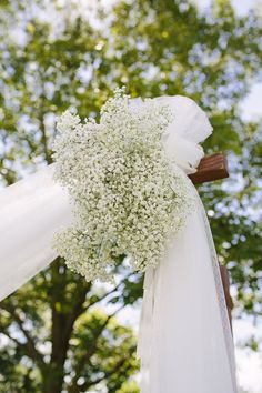 This wouldn't be hard to do...just bunch some baby's Breath and attach.