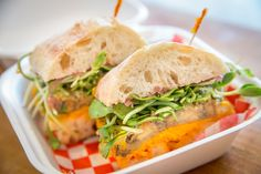 Vegan Marinated Eggplant sandwich with squash hummus, olive salad, sweet red onion jam and sunflower sprouts @ Dundas Park Kitchen Red Onion Jam, Eggplant Sandwich, Olive Salad, Eggplant Recipes, Vegan Restaurants, Places To Eat, Salmon Burgers, Hummus, Squash