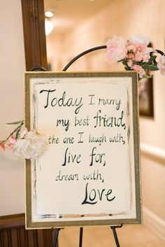 Frame pieces of wedding vows. This is a cute idea for decor in the ballroom area. Jazz it up w the engagement photos and you're on to something