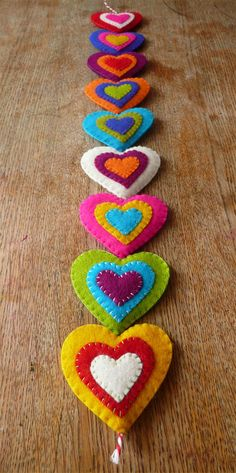 Colorful felt hearts door hanger / wall hanger 9 by HetBovenhuis