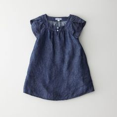 Now for the young ones as well, just like their stylish mothers and fathers! Kid's cap sleeve a-line dress coming in our signature plaids and prints. Round neckline, two front button detail at the front.    • two side pockets  • 100% cotton  • made in USA