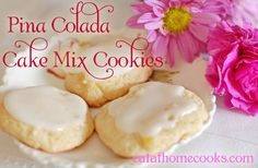 Pina Colada cookies made with cake mix. Haven't tried cake mix cookies yet. This may be the recipe I try first! YUM! And great for a summer/hawaiian party :)