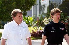 (L to R): Norbert Haug (GER) Mercedes Sporting Director talks with Mario Illien (SUI) Ilmor Engine Designer. Malaysian Grand Prix, Rd 2, Sepang, Kuala Lumpur, Malaysia, 19 March 2004