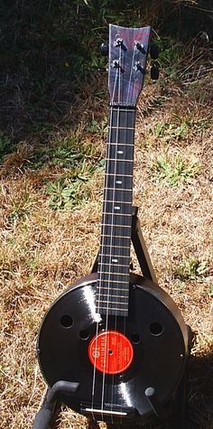 Re-purposed items formed into a banjolele of sorts. Fun to play but be careful not to scratch the vinyl or you might get stuck playing the same riff over and over and over and...