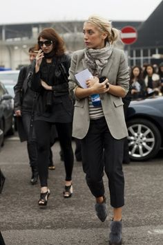 Long beige blazer, beige stripped top, cropped black trousers and pompom grey ankle boots. Paris street style