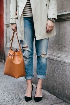 distressed denim + trench coat +bucket bag + stripes