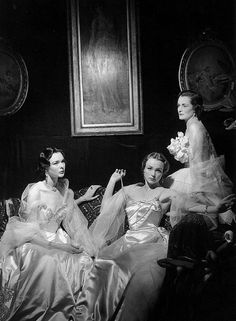 """""""The Wyndham-Quinn sisters, wearing gowns by Hardy Amies and Ronald Paterson."""""""