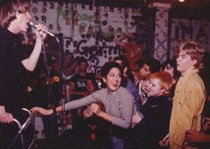 "Some LA Punk Rock History circa 1970's: ""Watching the Dickies! Nickey Beat (wearing a Bags t shirt), Dawn Wirth(?) Craig Lee, Brian Tristan aka Kid Congo Powers, Trudie Trudie, Hellin Killer, Bobby Pyn aka Darby Crash and yours truly. Leonard had broken his leg in my honor and I'm about to pull away his walker. Nice."" by Alice Bag photo shot at the Masque, 1977"