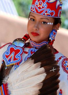 Native Indian beauty in traditional costume with fan. Costume for dance and ceremonies(probably)