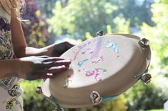We're all gypsies with this awesome paper plate tambourine!