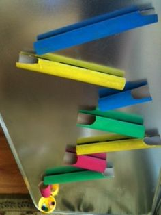 paper towel tubes, toilet paper tubes, magnets, small ball... create up the fridge!