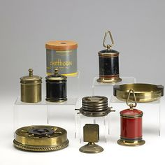 ART DECO SMOKING ACCESSORIES; Fifty pieces in assorted brass, copper or chrome include Chase and Revere ashtrays, cigarette holders and lighters