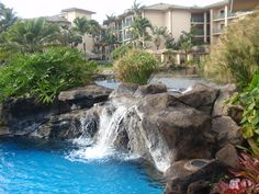 """Outrigger condo pool - Kauai. My kids called this the """"hidden mermaid cave.""""  You could swim under the waterfall and sit on rock in a little alcove. So cool!!"""
