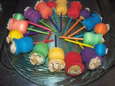"""Parrot """"lollypops"""", maybe put a wood chip over the top. Would be fun to chew through wood to get the food."""