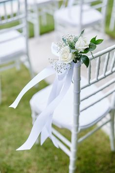 White rose, baby's breath and green leaf chair decoration Destination Wedding Planner, Wedding Planning, White Roses Wedding, Aisle Flowers, Wedding Aisle Decorations, Chair Backs, Baby's Breath, Wedding Chairs, Unique Weddings