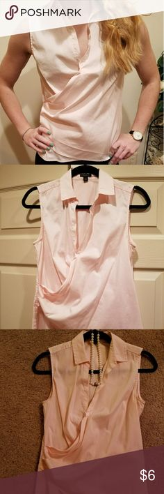 Ann Taylor Sleeveless Wrap Blouse Sz 4 Baby Pink sleeveless wrap blouse in a size 4 from Ann Taylor. Very soft and feminine. Excellent condition from a clean smoke free home. Feels like 100% cotton. Ann Taylor Tops Blouses
