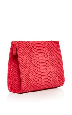 Designer Danielle Corona draws on experience at Valentino for her ultra-luxurious accessories crafted from the finest exotic skins. Finished with handmade Italian hardware, this **Hunting Season** clutch is crafted from cherry red python skin for an exquisite evening accessory.