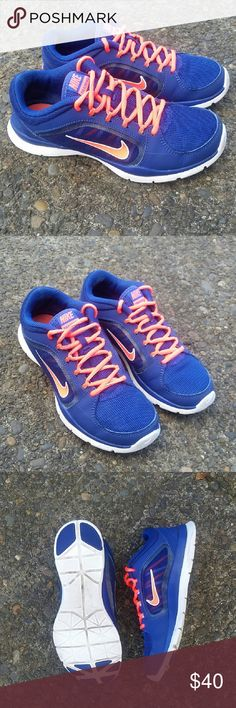 NIKE TRAINING WMNS SIZE 6 Gently pre-owned pair of Nike running shoes in excellent condition.  Color: Royal blue with neon pink. Beautiful bright colors. No rips, no stains,  no odors. Women's size 6. Nike Shoes Athletic Shoes