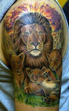 Glamorous lion pride on sunset tattoo on sleeve
