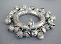 One of an old pair of hollow-silver three parts anklet from Rajasthan, Northern India or Andhra Pradesh. With attached clusters of hollow silver bells (gola). Very good silver alloy, containing copper. | 760$ for the pair