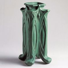 The Morse Museum's Arts and Crafts collection includes almost 1000 examples of American art pottery such as this Teco vase which shows the potterys signature green glaze. Gates Potteries which produced the Teco line was established in an idyllic country setting near Chicago. Designers for Gates Teco Pottery included Fernand Moreau (18531920) Frank Lloyd Wright and William Day Gates (18521935). Vase c. 1905. No. 72; Teco Pottery; glazed clay; Gates Potteries Terra Cotta Illinois (PO-030-82)…