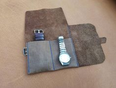 This case is perfect to keep in order your watches. For greater security it is made with two lids. In this roll there are no parts that can scratch your watches. The roll closes with a leather strap with stainless steel buckle. It can also be used as tool case, make up pouch or pencil case. The size of each pocket - 2 15/16 inch ( 75 mm ) The quantity of pockets available to order - 2 to 6 At your request, we can change the size of the pockets. Just write about it. You have the optio...