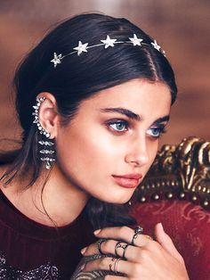 Taylor Ear Cuff | Edgy ear cuff featuring antique silver plating and clear glass crystals, with dangling accents extending from the bottom. Cuff stays securely on the ear with both a post closure, and clasp.