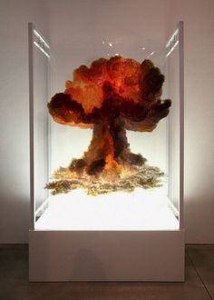 """Israeli artist Eyal Gever explores catastrophic events through his art. In his pieces known simply as Nuclear Bomb and Large Scale Smoke, he fabricates the fiery mushroom cloud that forms from an atomic explosion and the suffocating carbon and debris that billows from a volcanic eruption, respectively. Gever explains his fascination with disaster by saying, """"My work captures and freezes catastrophic situations as cathartic experiences."""""""