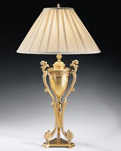Solid brass table lamp with Greek urn design. Antiqued solid brass lamp with tripod base and classic Greek urn design. This brass lamp has round pleated fabric shade Bedside Table Lamps, Table Lamp, Classic Lighting, Brass Table Lamps, Floor Lamp, Brass Lamp, Floor Lamp Table, Gold Table Lamp, Luxury Lamps