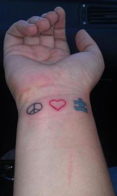 peace love and autism -tatoo; looks still a little sore!
