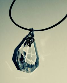 crystal and silver leaf necklace on leather cord