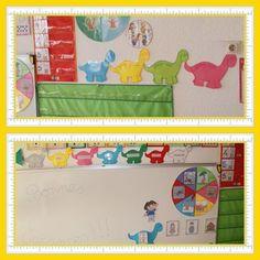 Coin regroupement : tableau des étiquettes de présence, groupes de couleur, saisons, jour de la semaine, habillons Dora, nombre d'absents