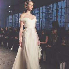 Brides.com: Spring 2015 Wedding Dress Trends Romantic and timeless, off-the-shoulder dresses were the hottest new necklines of the Spring 2015 runways. Many designers went from crafting one-shoulder, cap and illusion sleeves to draping these sweet new necklines, fit for the slightly bohemian bride with a penchant for graceful gowns with a ton of movement.Photo: Brides via Instagram