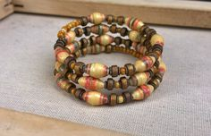 Paper bead memory wire bracelet  warm colors  yellow by stillrain