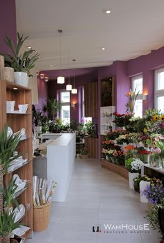 Modern florist in Poznań (Poland) - full of white and violet colour.