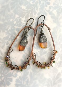 Around and Around Copper and Gemstone Artisan Earrings by Angela Gruenke of Contents Jewelry by ContentsJewelry on Etsy https://www.etsy.com/listing/580120727/around-and-around-copper-and-gemstone