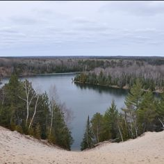 Au Sable River, Oscoda, MI We've been down this steep sand dune.  Getting back up to the top is a workout.