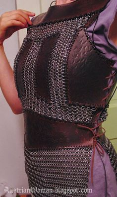 "Leather panels sewn onto chainmail. A good idea to avoid the ""beginning larper"" look."
