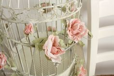 Wrapping flowers around my birdcage