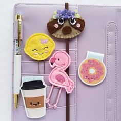 So in love with my macaron planner already! Look at all these cuties!!  Shops tagged. #funusualsuspects #planner #plannergeek #plannerlove #macaronplanner #plannernerd #sewinthemoment #feltclips #flamingo #lemon #sloth #planneraddict #plan2017 #magneticbookmarks