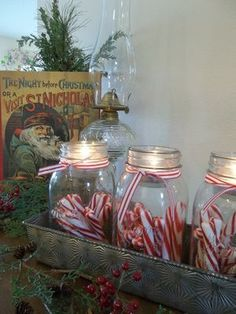 2015 put this in the narrow black tray Simple Christmas Candy Country Decoration. I love putting peppermint sticks in ball jars. Prim Christmas, Christmas Candy, Simple Christmas, Winter Christmas, Christmas Dishes, Primitive Country Christmas, Christmas Kitchen, Primitive Crafts, Outdoor Christmas