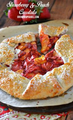 Looking for an easy dessert recipe using summer fruit? This strawberry peach crostata recipe is an easy fruit after dinner dessert. Just fill a pie crust with fruit and bake. Skip the pie this summer and try a rustic tart instead with this quick dessert.