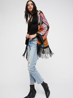 Passion Flower Silky Kimono   In a silk-blend, this colorful kimono is embellished with beautiful bead detailing.    * Sheer   * Statement fringe trim