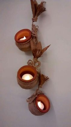 Hanging pots diyas by TOTAL WASTE and PAPIER