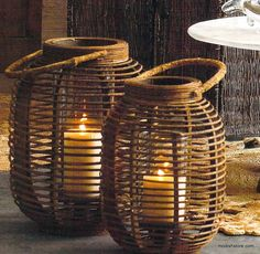 Waving lines of light pour through the open weave of these rounded rattan lanterns. Each features an elevated glass hurricane and a natural handle. Perfect for outdoor entertaining.