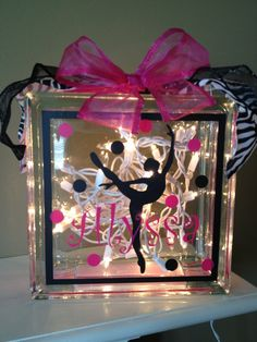 Glass Block with interior lights and ribbon.  Choice of painted or custom vinyl ballet or dance design with customized name.